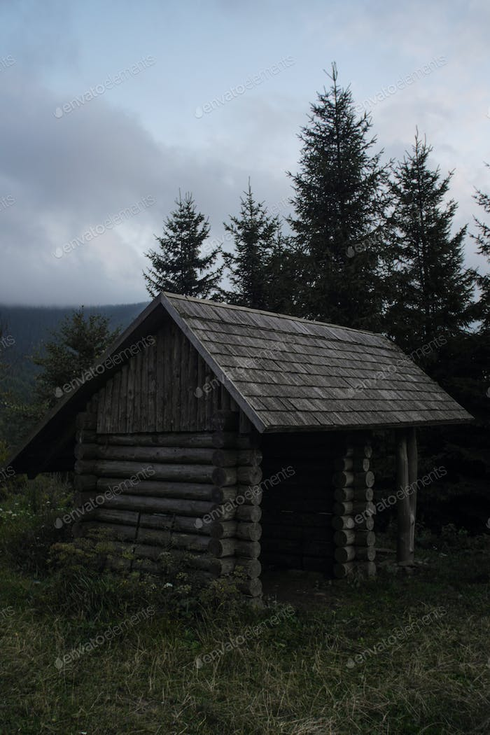 simple wooden cabin used as a hiking shelter, czech republic