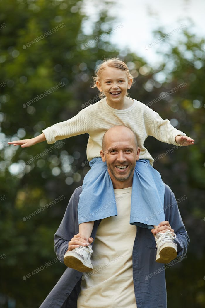 Happy Little Girl Riding on Fathers Shoulders