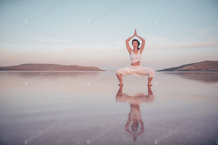 Smiling girl practicing yoga outdoors