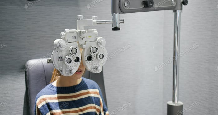 Woman checks her eyes