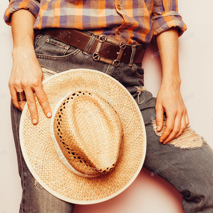 Country Cowboy style hat, jeans, plaid shirt