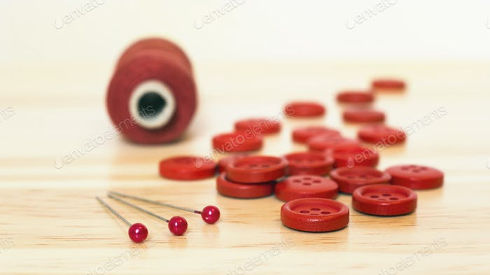 Red sewing supplies close-up