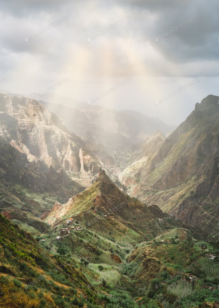 Mysterious sunrays shining on mountain peaks in Xo-Xo valley of Santa Antao island in Cape Verde