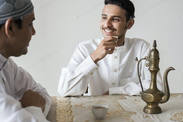 Muslim men having a cup of tea