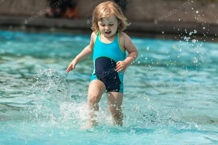 Little girl in a public pool for kids