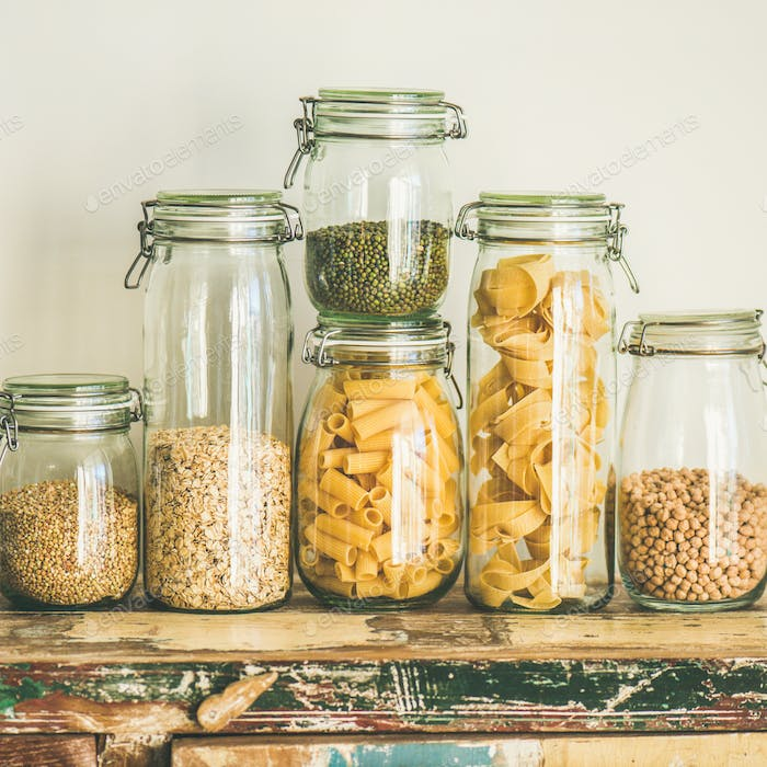 Uncooked cereals, grains, beans and pasta on table, square crop