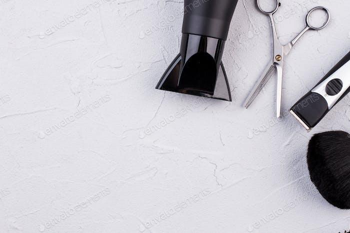 Hairdresser set on grey textured background.