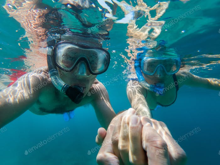 Underwater view of couple snorkeling