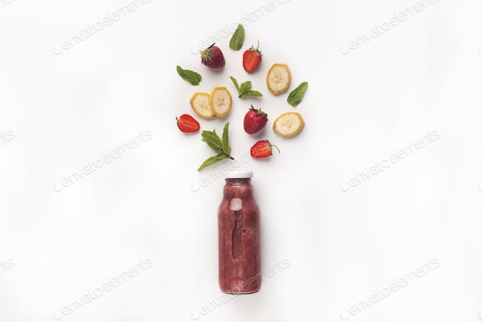 Creative composition with different fruits and detox smoothie