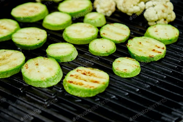 Grilled zucchini vegetable on huge gas grill .