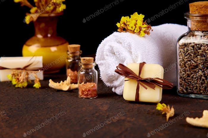 Spa concept. Aromatic candles, soap beauty and Spa cosmetic products, salt,