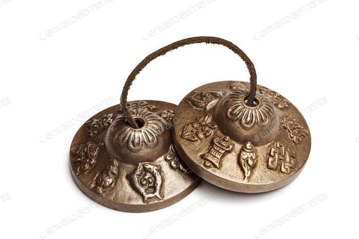Tibetan Buddhist tingsha cymbals isolated
