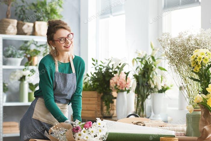 Florist wearing modern eyeglasses