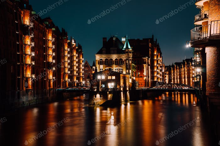 The Warehouse District - Speicherstadt at night. Tourism landmark of Hamburg. View of Wandrahmsfleet