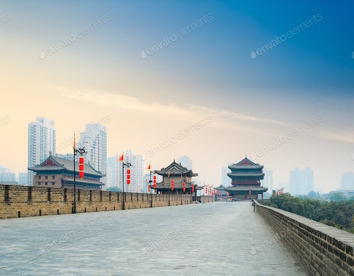 xian city wall with tower at dusk