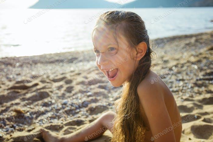 Joyful young girl on the beach