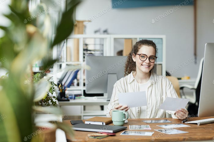 Female Editor at Desk in Publishing Office