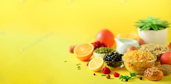 Vegetarian breakfast. Soft boiled egg, oat flakes, nuts, fruits, berries, milk, yogurt, orange