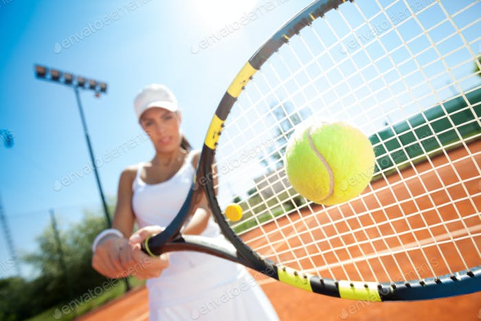 tennis player hitting the ball