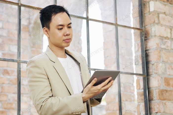 Businessman reading e-mail
