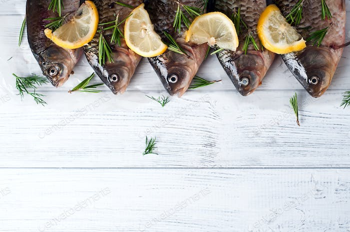 Fresh fishes tails with lemon