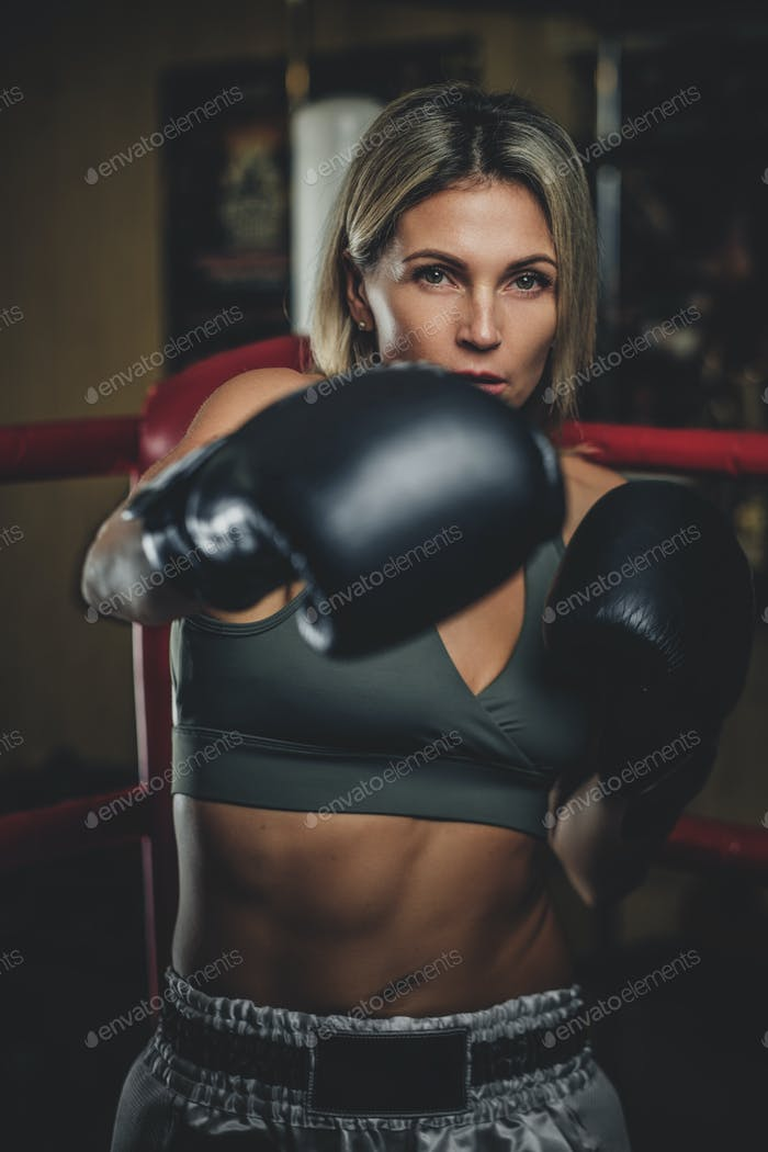 Portrait of experienced female boxer