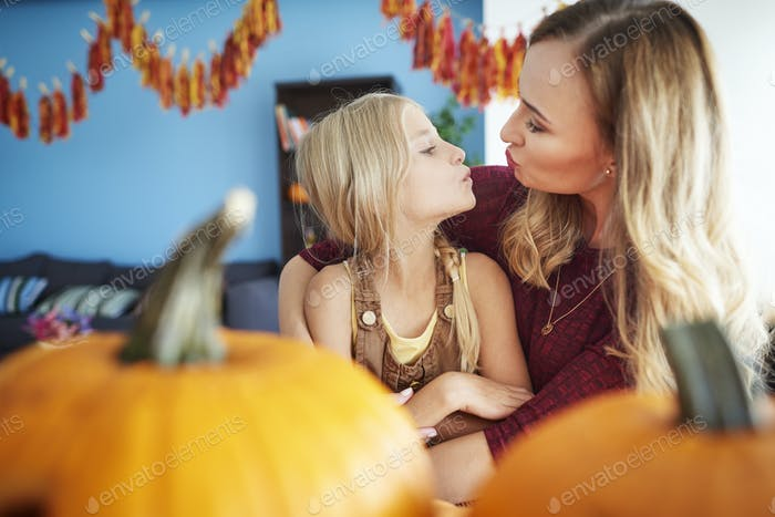 Small kiss from mum for her daughter