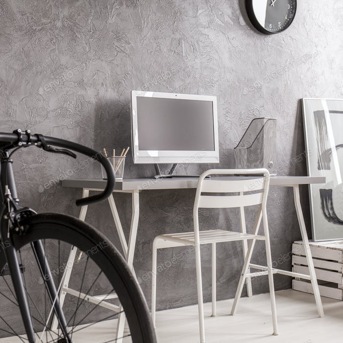 Grey minimalist room with black bike