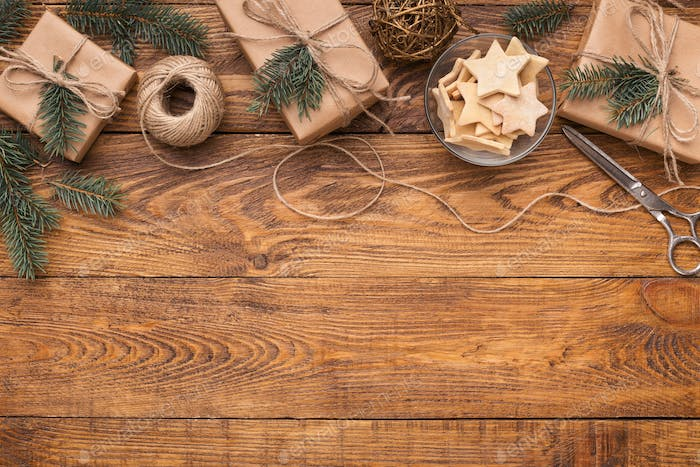 Craft Christmas presents on wooden table, copy space