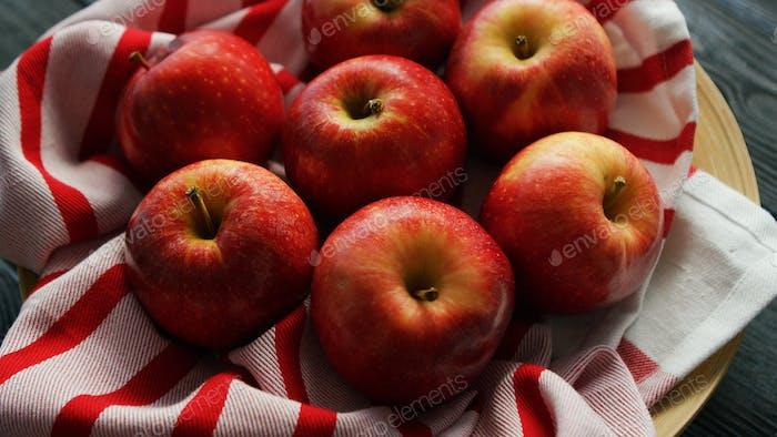 Fresh apples on napkin