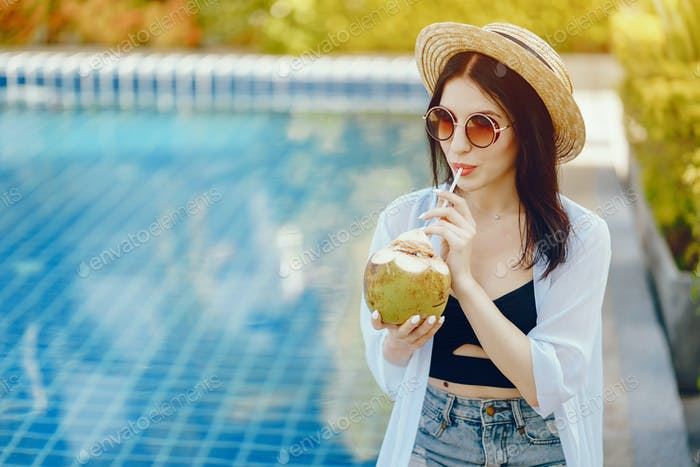 girl drinking fresh juice from a coconut