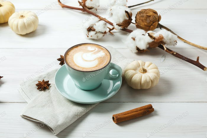 Pumpkin spice latte. Coffee cup on white wood background