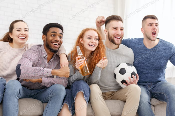 Friends cheering sport league, watching football together