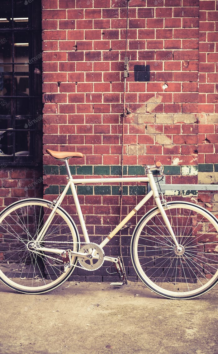 City bicycle on red wall, retro vintage bike