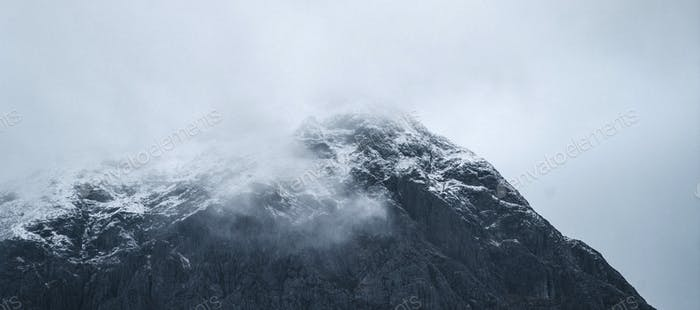 Snowy mountain on a misty day