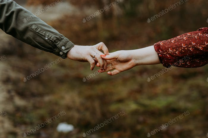 Holding hands of lovers
