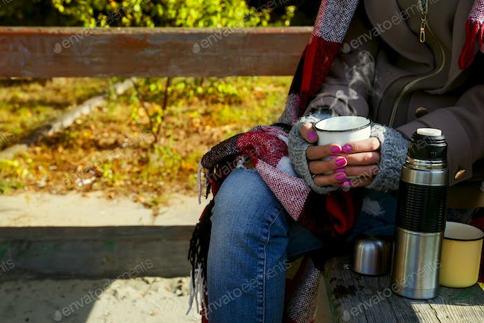 Girl with a cup of hot herbal tea