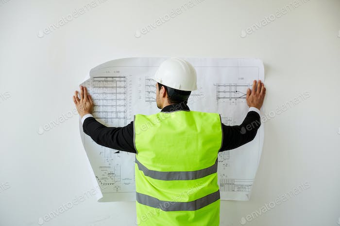 Engineer Studying Plans