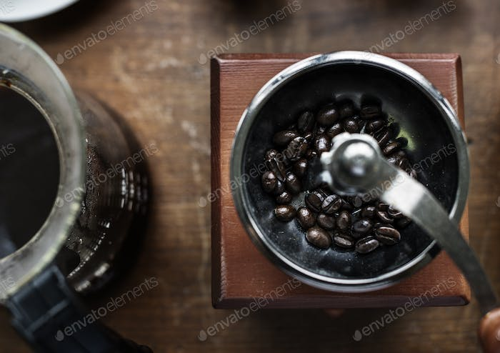 Closeup of coffee grinder on wooden table