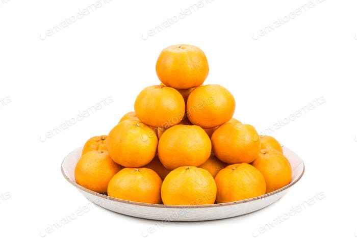 Stack of mandarin oranges in tray with white background