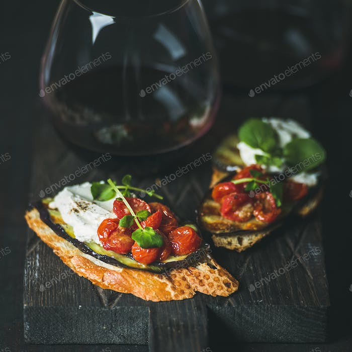 Wine, brushetta with eggplant, tomatoes, garlic, cream-cheese and arugula