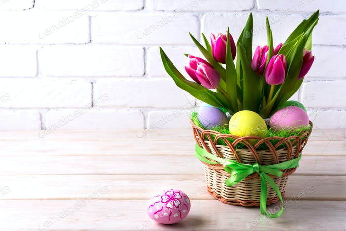 Easter table centerpiece with pink tulip