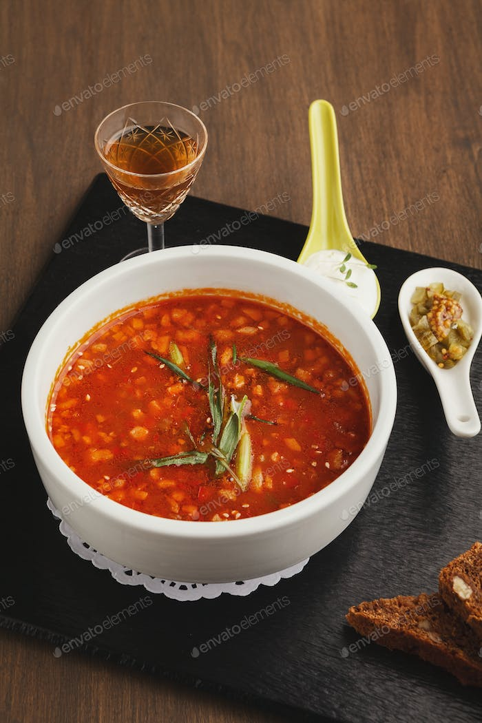 Delicious russian soup with snacks and drink