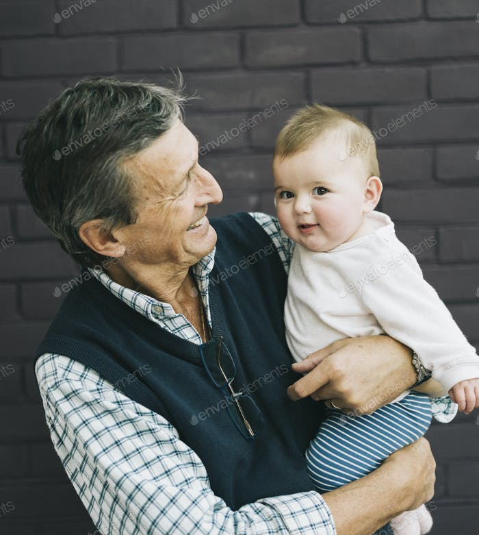 A grandfather and baby granddaughter.