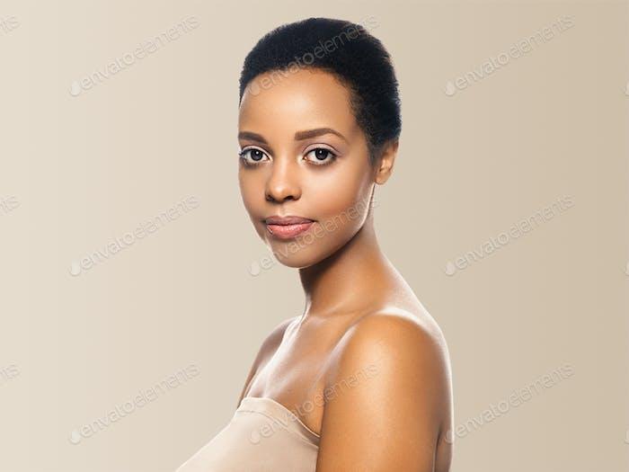 Black skin beauty woman healthyskin teeth and hair model. Beige background.
