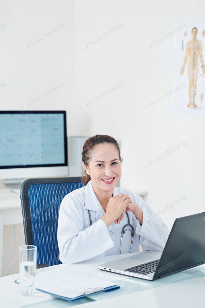 Physician working on laptop