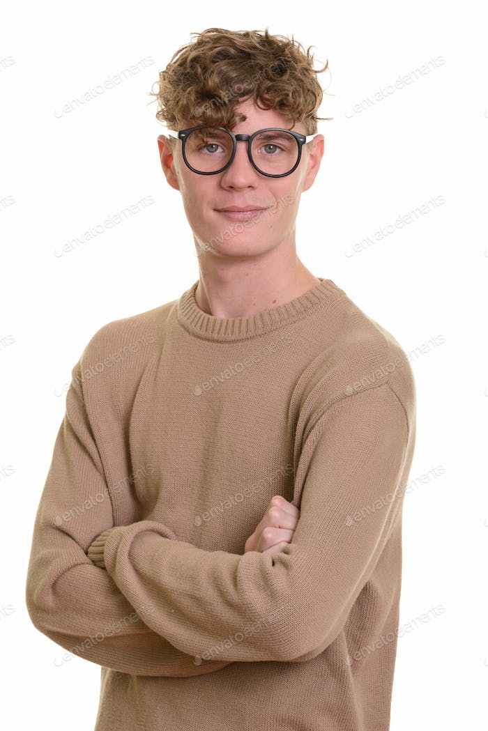 Young handsome man with curly blond hair wearing eyeglasses