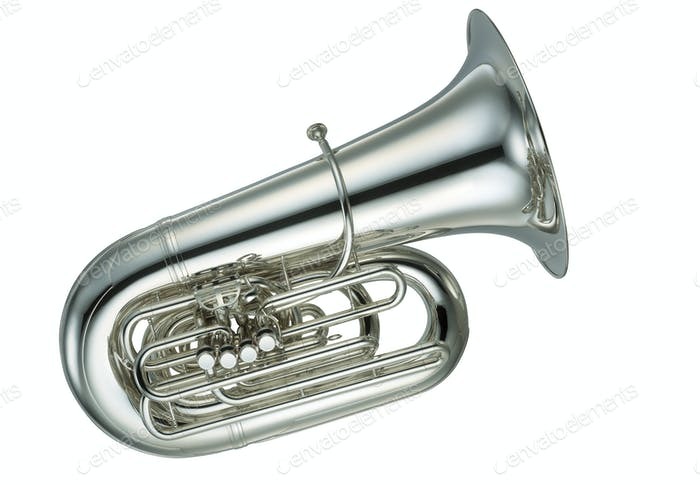 Large gold brass tuba on white background