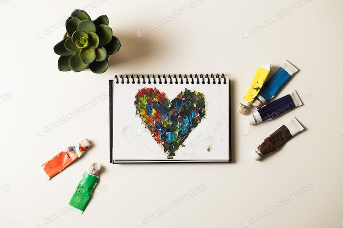 Acrylic hearts on notebook