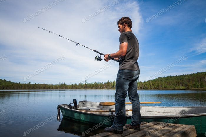 Young Adult Fishing in a calm Lake